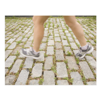USA, New York City, Blurred legs of woman Postcard
