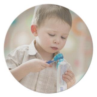 USA, Utah, Lehi, boy (2-3) brushing teeth Plate
