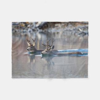 USA, Wyoming, Mule Deer bucks swimming lake Fleece Blanket