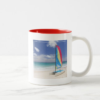 View Of Beach With Sailboat Two-Tone Coffee Mug