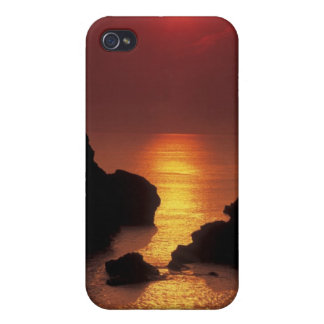 view of the sun setting over the sea cover for iPhone 4