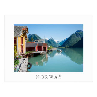 Village and a fjord in Norway white text postcard