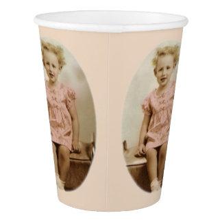 Vintage little blonde girl in pink dress paper cup