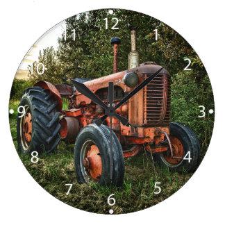 Vintage old red tractor clocks