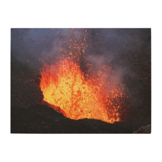 Volcano landscape: hot lava erupting from crater wood print