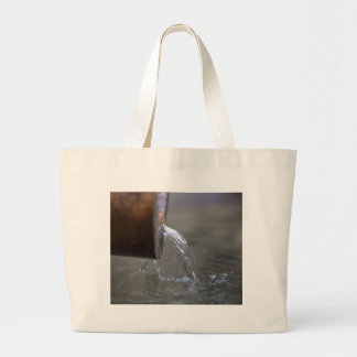 Water stream on  a well large tote bag