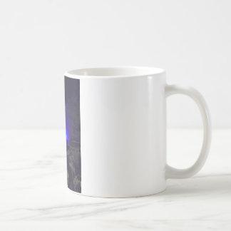 Waterfall in winter coffee mug