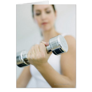 Weightlifting. Woman lifting dumbbells. This Card