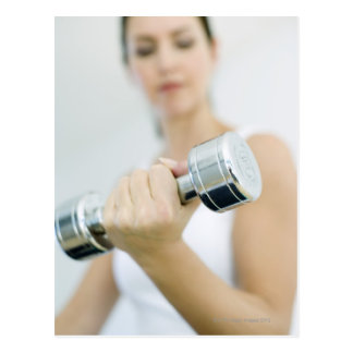 Weightlifting. Woman lifting dumbbells. This Postcard