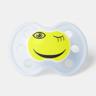 White and blue winking smiley pacifier. dummy