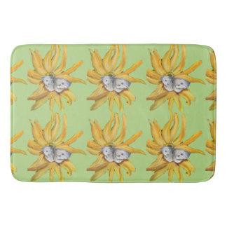 white butterfly on yellow flower bath mats