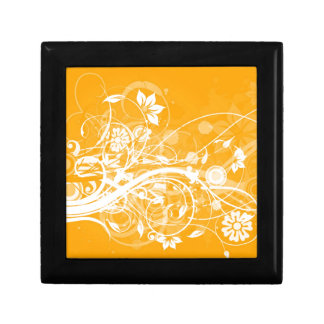 white floral swirls on yellow background gift box