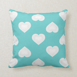 White hearts pattern on turquoise throw pillow