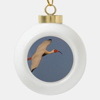 White Ibis in Flight Ceramic Ball Christmas Ornament