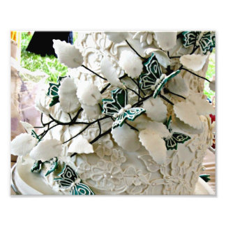 White lacy wedding cake with green butterfies photo print