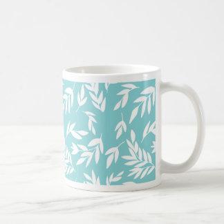 White leaves in mint blue coffee mug