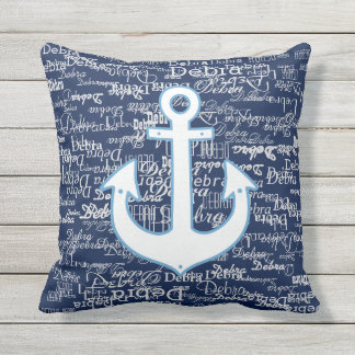 white pattern of names & boat anchor, on blue outdoor cushion