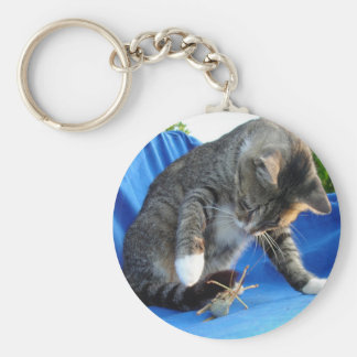 White Pawed Tabby Cat Playing With Winged Insect Key Ring