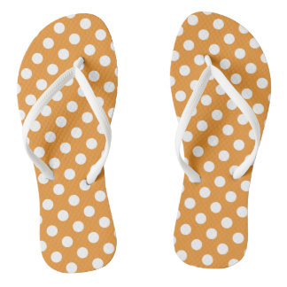 White polka dots on amber jandals
