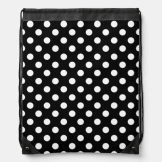 White Polka Dots on Black Background Drawstring Backpacks