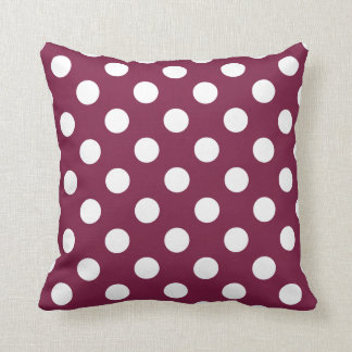 White polka dots on burgundy cushion
