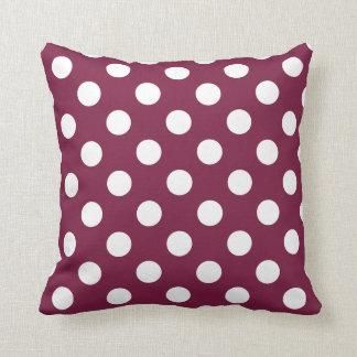 White polka dots on burgundy throw pillow