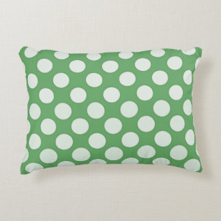 White polka dots on lime green accent cushion