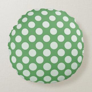 White polka dots on lime green round cushion