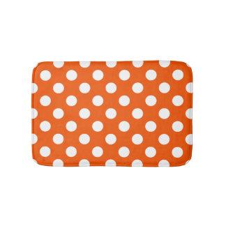 White polka dots on orange bath mats