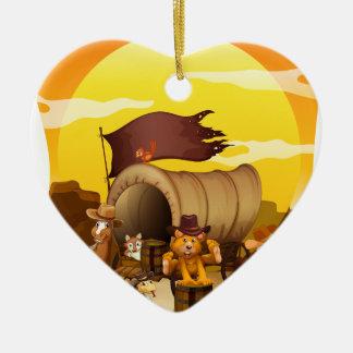 Wild animals by the wagon ceramic heart decoration