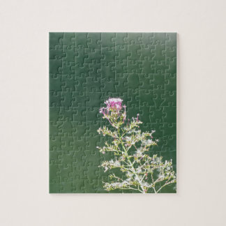 Wildflowers against the water surface of a river jigsaw puzzle