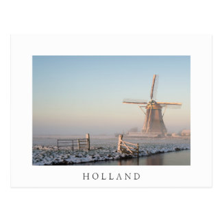 Windmill in the snow at sunrise postcard with text