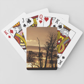 Winter trees silhouettes with sunrise playing cards
