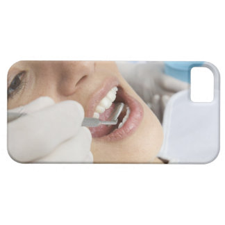 Woman, aged 27, being examined in a dentists barely there iPhone 5 case