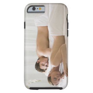 woman and man lying on massage benches tough iPhone 6 case