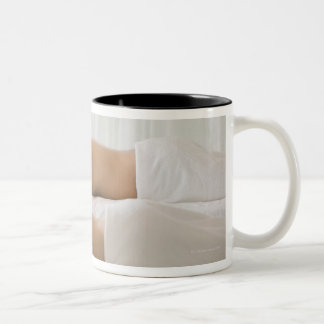 woman and man lying on massage benches Two-Tone coffee mug