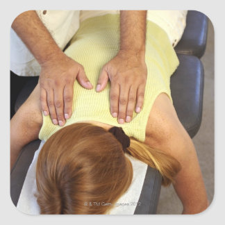 Woman at chiropractic appointment square sticker