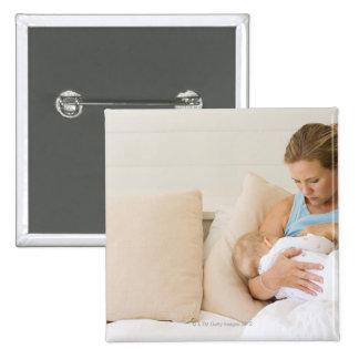Woman breastfeeding baby 15 cm square badge