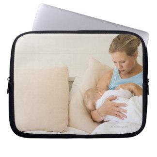 Woman breastfeeding baby laptop computer sleeve