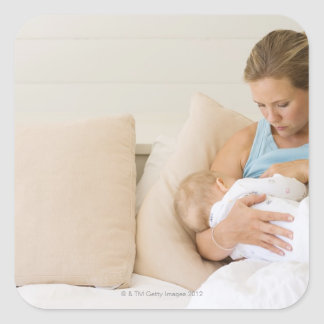 Woman breastfeeding baby square sticker