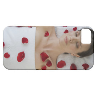 Woman covered in flower petals laying on massage iPhone 5 cover