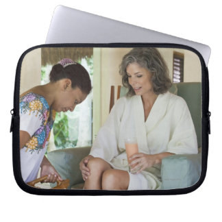 Woman getting a footbath at a spa in Mexico. Laptop Sleeve