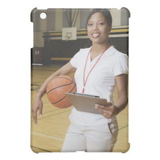 Woman holding basketball and clipbpard, smiling, iPad mini case
