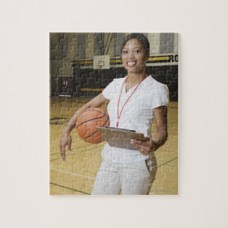 Woman holding basketball and clipbpard, smiling, puzzle