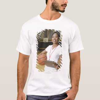Woman holding basketball and clipbpard, smiling, T-Shirt