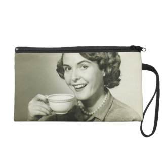 Woman Holding Cups Wristlet