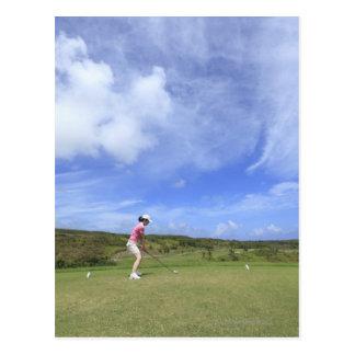 Woman playing golf postcard