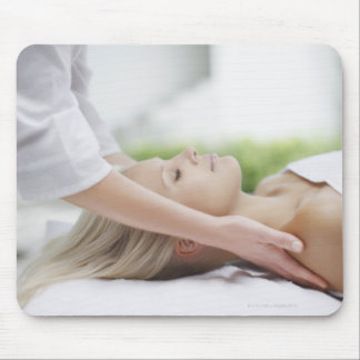 Woman receiving massage mouse pad