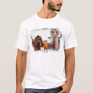 Woman taking pills from medicine cabinet T-Shirt