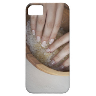 Woman touching bowl of sugar case for the iPhone 5